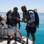 dive hurghada-diver-friend-buddy-diving-red sea-boat-enjoy