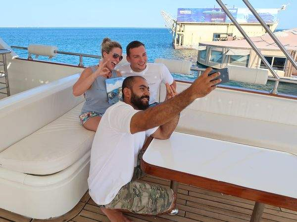 Guests celebrating finishing their open water course on Dive-hurghada boat