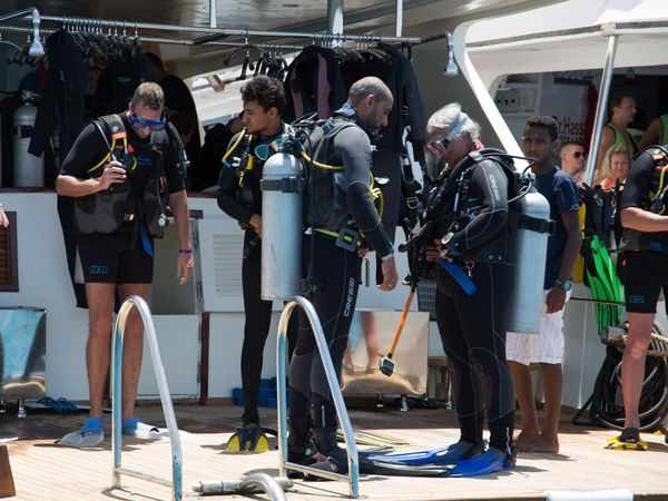 Red sea divers doing buddy check and getting ready to dive from Dive-Hurghada boat